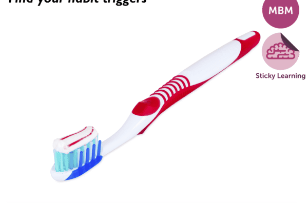Red and white toothbrush with toothpaste on