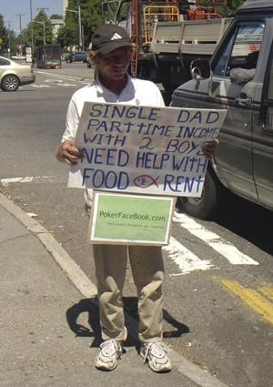 Influencing Styles: Man with sign 'single dad dad part time income with 2 boys need help with food'