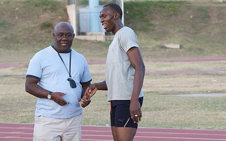 Usain Bolt and Coach.