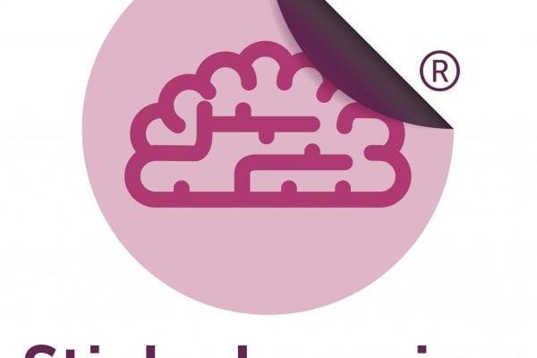 Icon of a purple brain on a pink sticker
