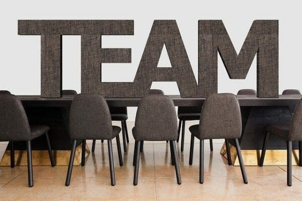 table with the words'team' on it - company culture