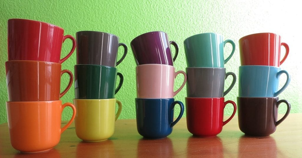 stacks of multi coloured cups leadership styles