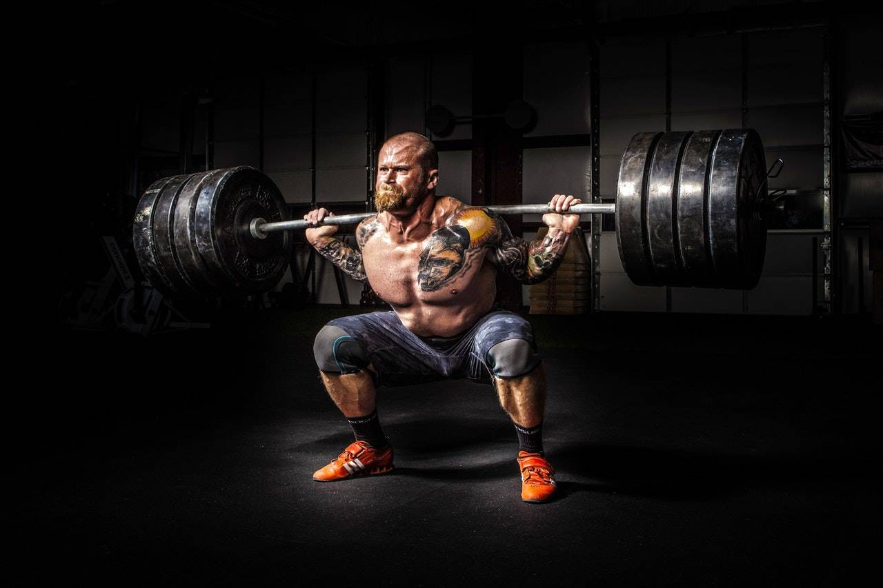 Email overload: Man lifting weights