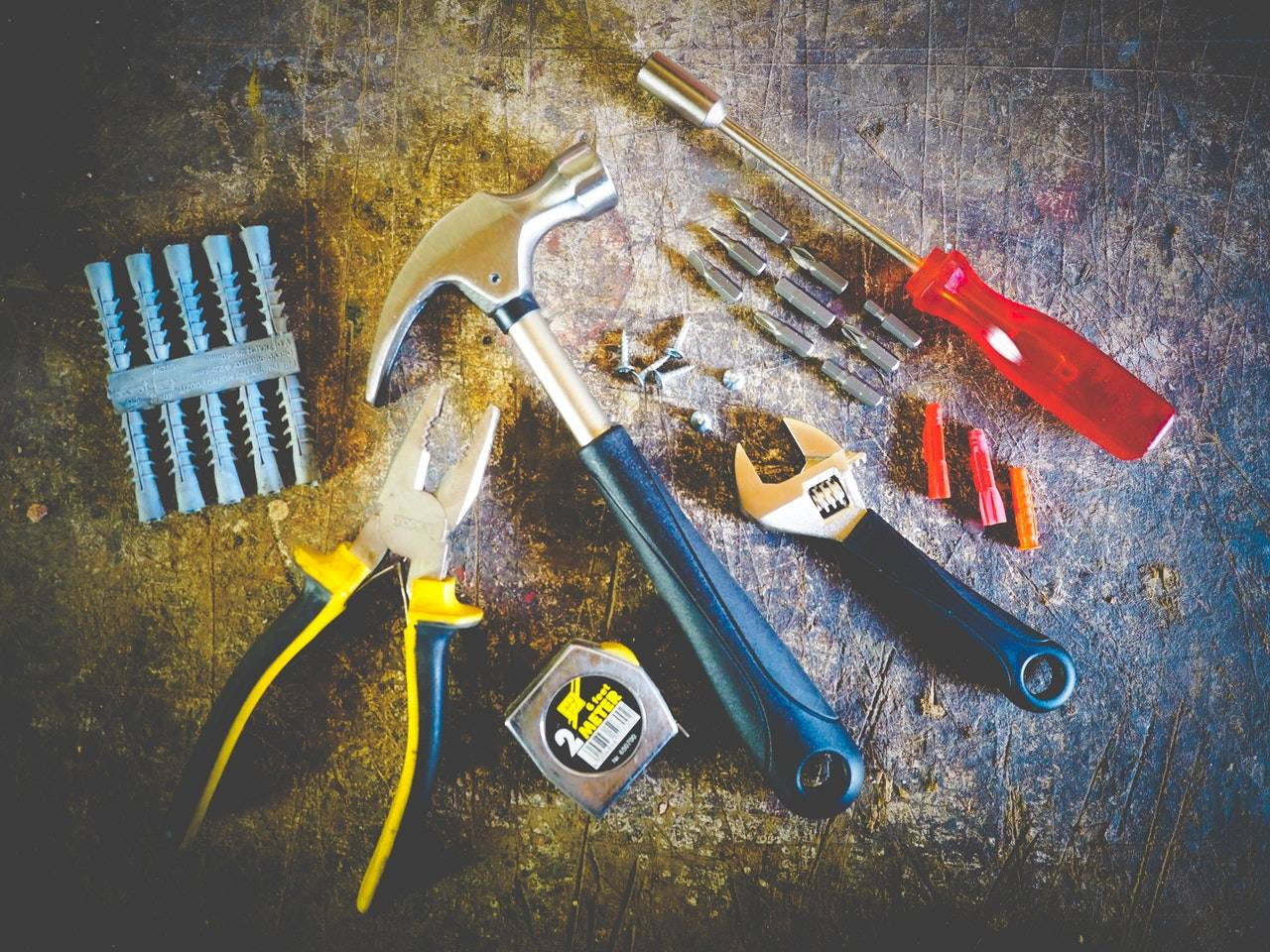 tox, pliers, hammer, wrench, tape measure, screwdriver