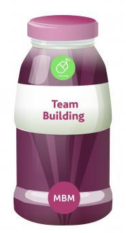 Pink bottle with label Team Building