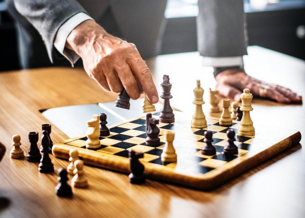 Businessman playing chess- Strategy