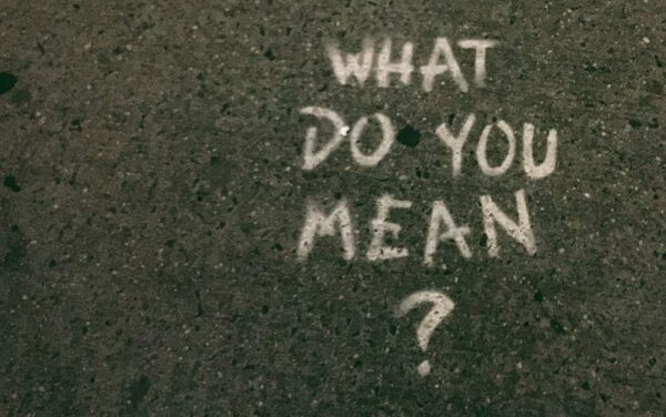 """a pavement with """"What Do You Mean?"""" written on it"""