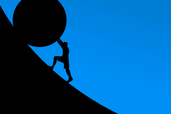 Silhouette of a man rolling a big boulder uphill