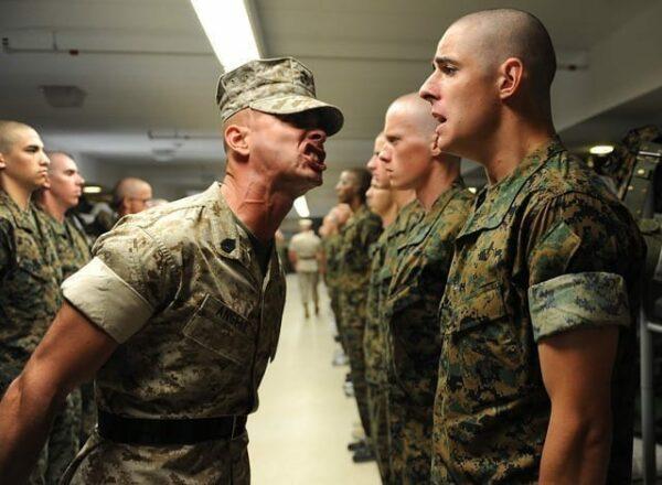 Drill instructor yelling at cadet