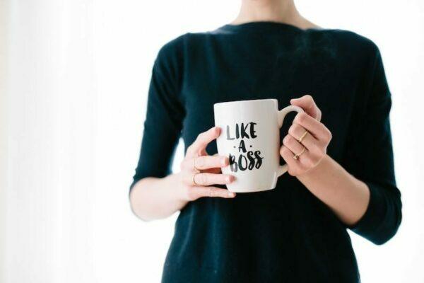 Woman holding a mug that says Like a Boos