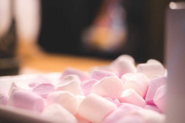 A bowl of pink and white marshmallows