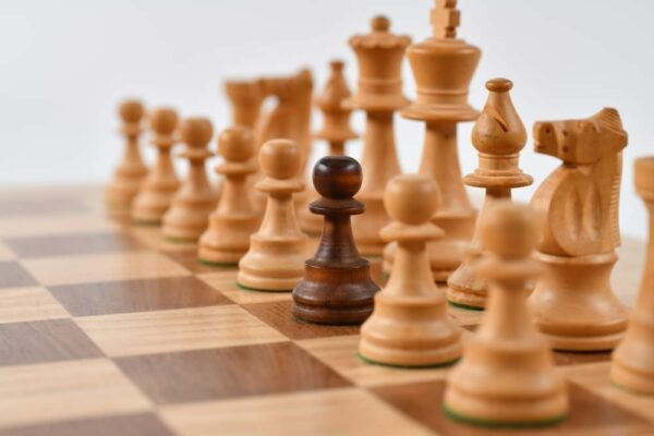 Black pawn lineup up together with the white pawns along the chessboard