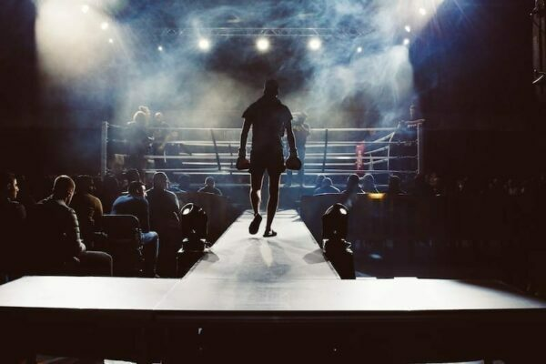 Team conflict, boxer entering a ring