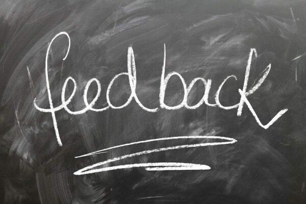 The word feedback written on a blackboard in white chalk