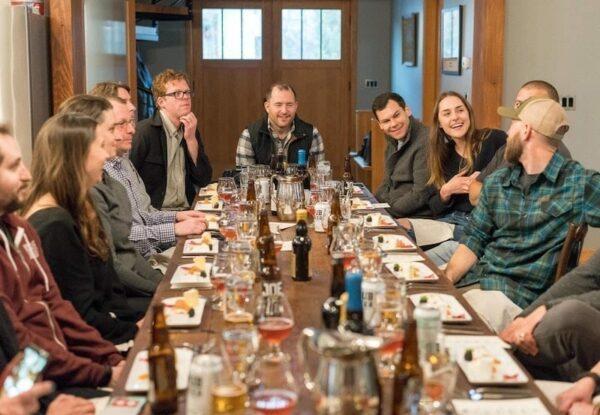 A team having a nice meal on a long table