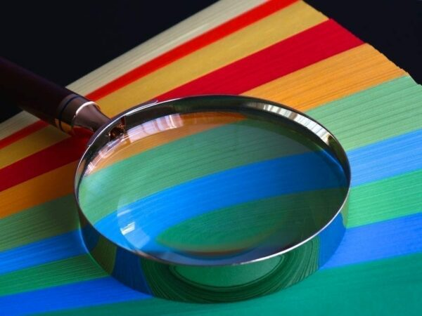 Magnifying glass on top of papers
