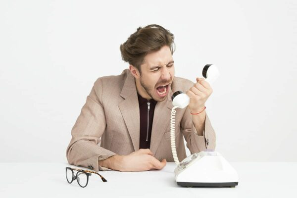Man shouting at the telephone