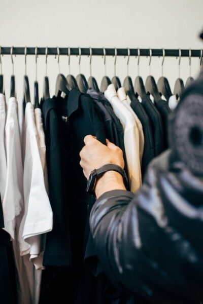 Man browsing through neatly hanged clothes