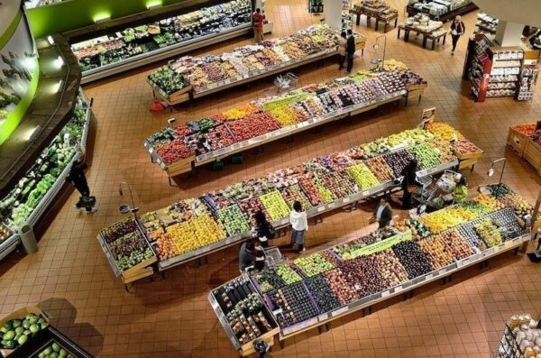 People shopping for fruits in a grocery store