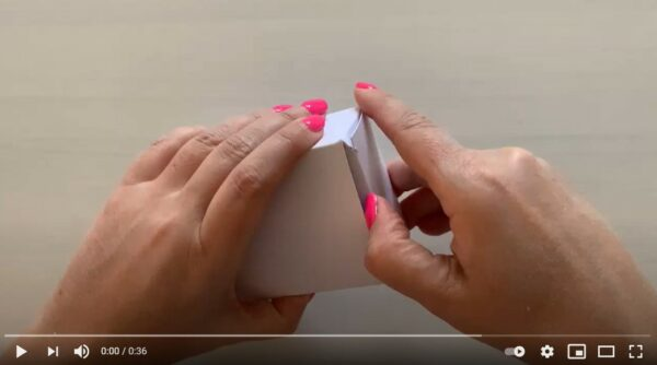 Coaching Cards being shown by a woman's hand in a YouTube video