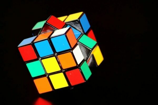 A Rubik's cube on its axis on a black background