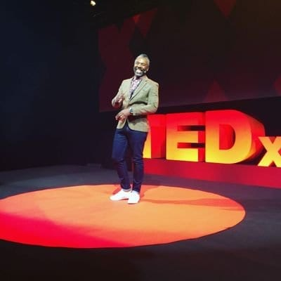 Derek Bruce on stage at a Ted Talk