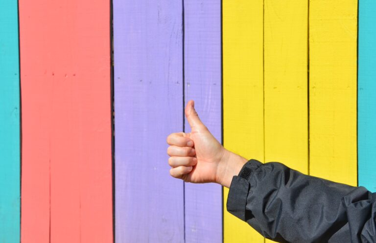 Multi-coloured wooden panels with a thumbs up