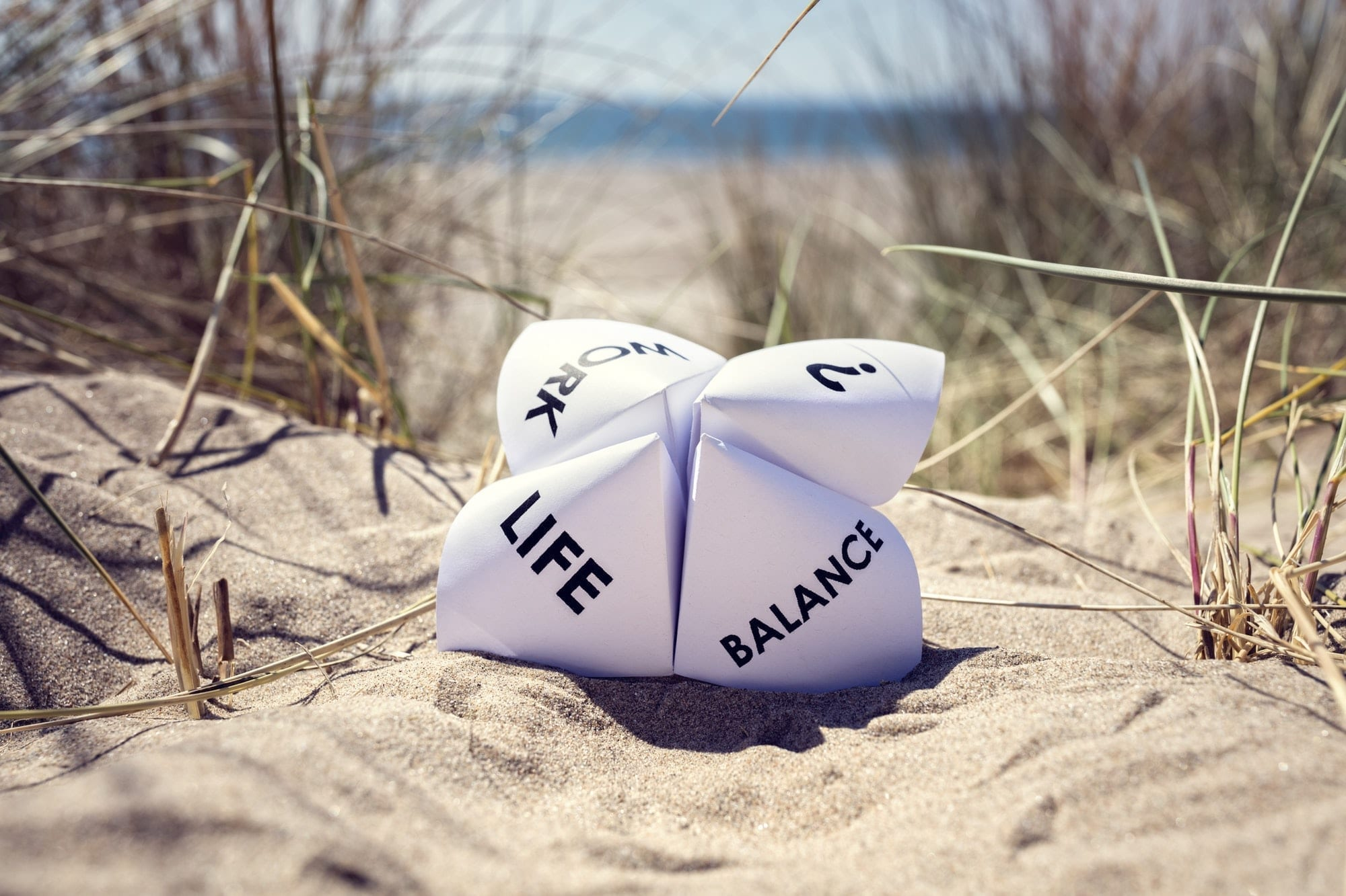 Paper fortune teller showing work life balance