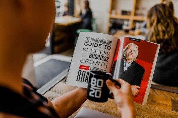 Man reading Richard Branson book