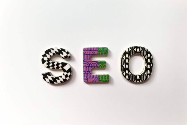 The letters SEO in patterned design laid on a white surface