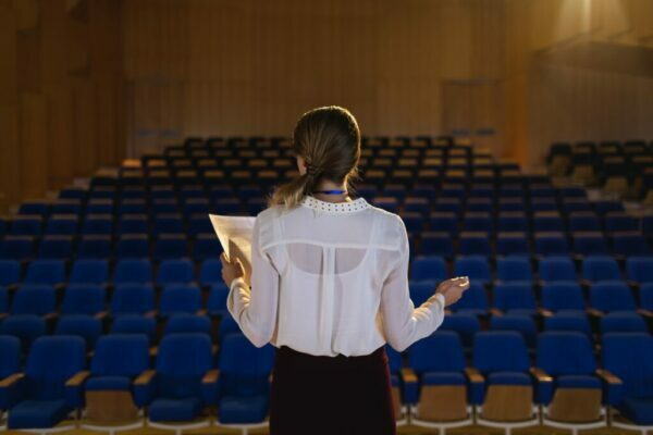 Woman practising a presentation in front of no audience