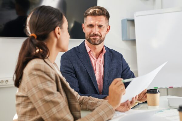 Manager Explaining Deal to Client