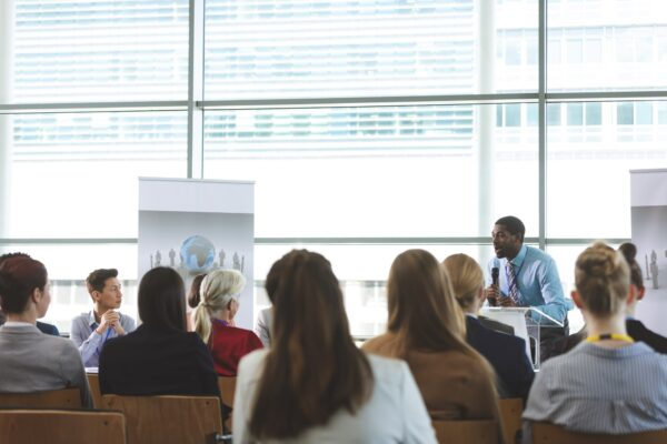 Speaking in a business seminar in modern office building