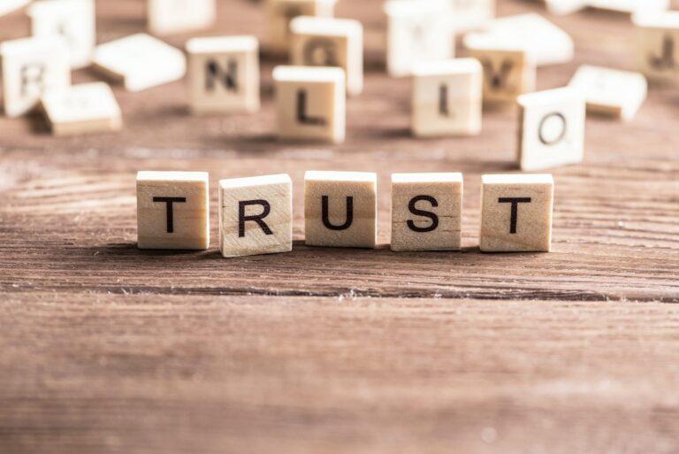 Word trust written on small wooden tiles