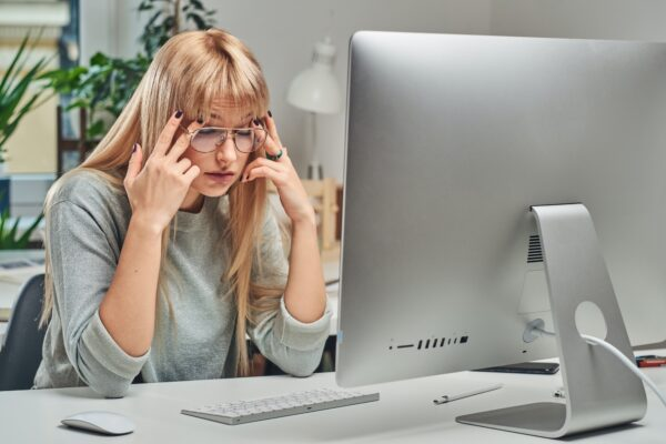 Woman feels tired while working in the office