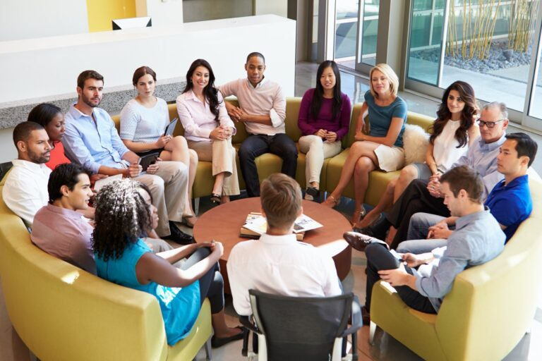 Multi-Cultural Office Staff Sitting Having Meeting Together, Cross-cultural communication