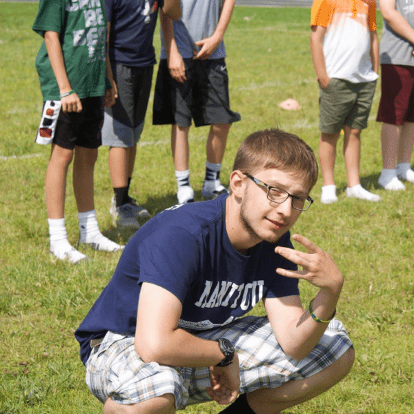 Joseph Bunkle crouching on the floor posing for camera