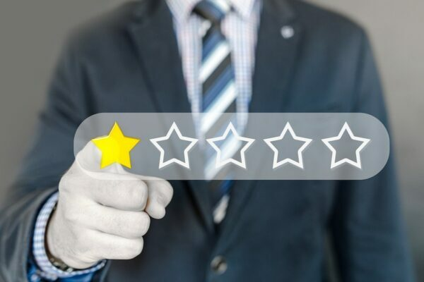 Businessman pointing to a 1 star out of 5 review