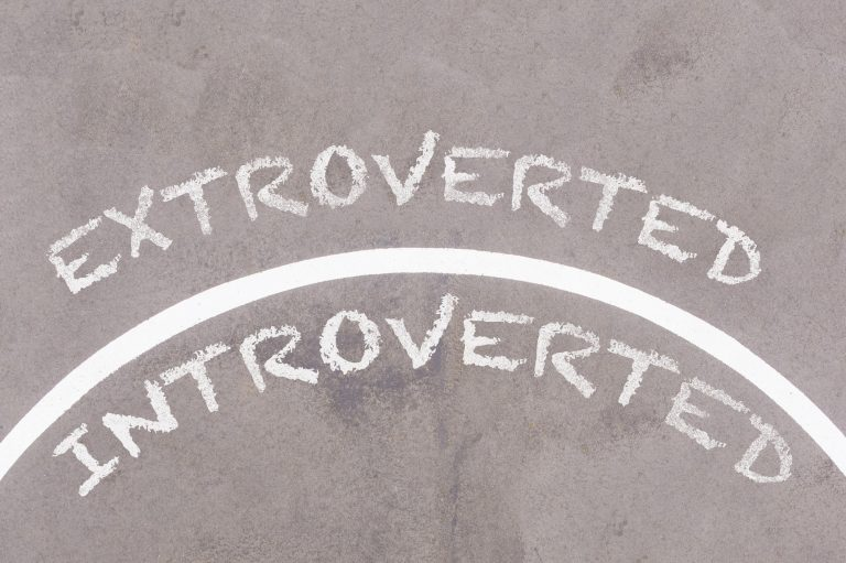 Extroverted vs Introverted text on asphalt ground