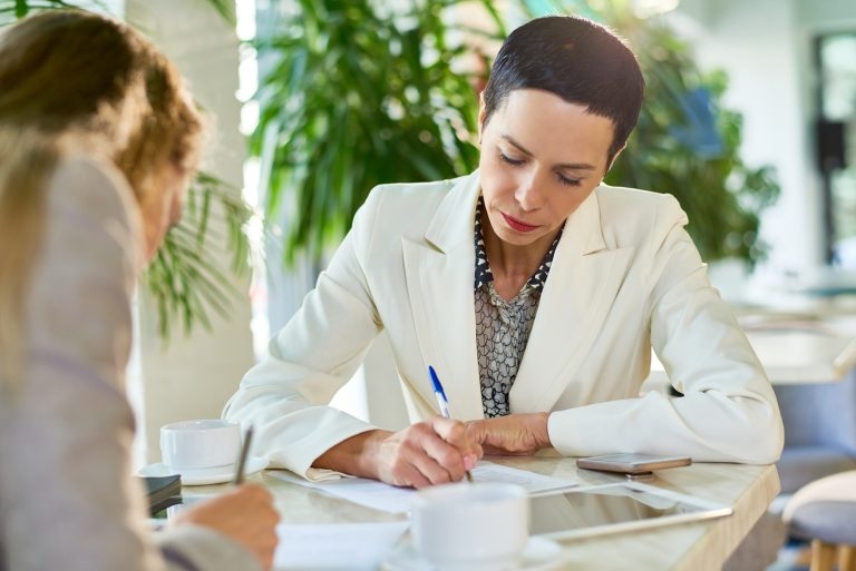Assertive Female Business Leader Signing Papers