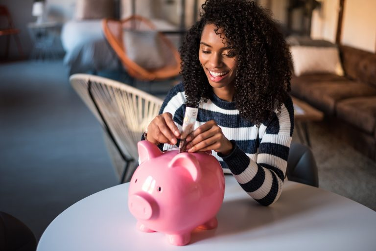 Woman with savings piggy bank, gen z prioritise financial security