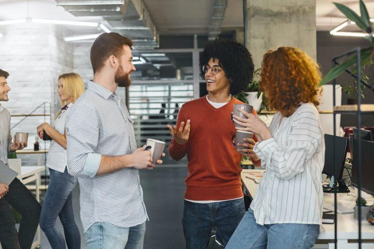 Diverse millennials enjoying communication in modern office