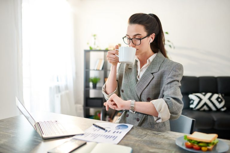 Businesswoman Checking Time, 80:20 Rule