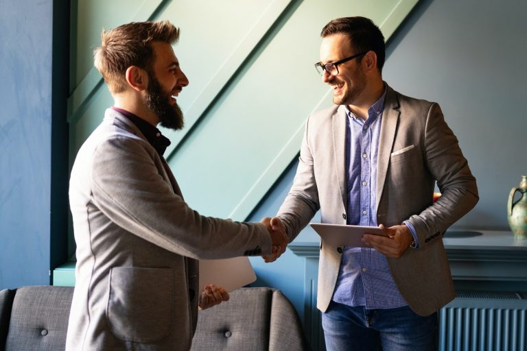 Business handshake and business people concept. Partnership, deal, agreement