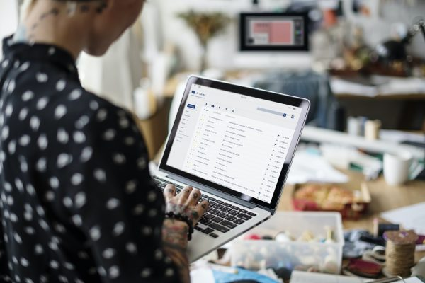 Woman looking at her email inbox on laptop