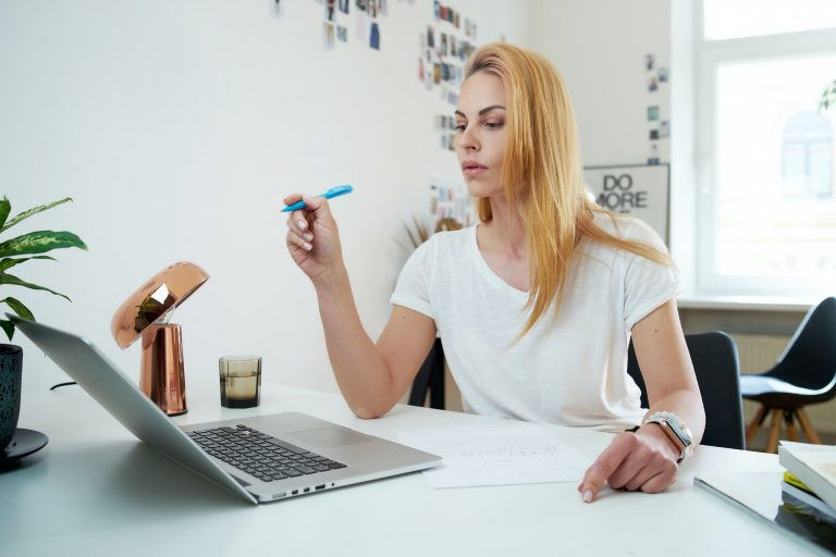 Female secretary points to laptop improving time management skills