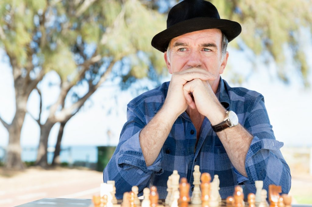 Man with chessboard looking into the distance