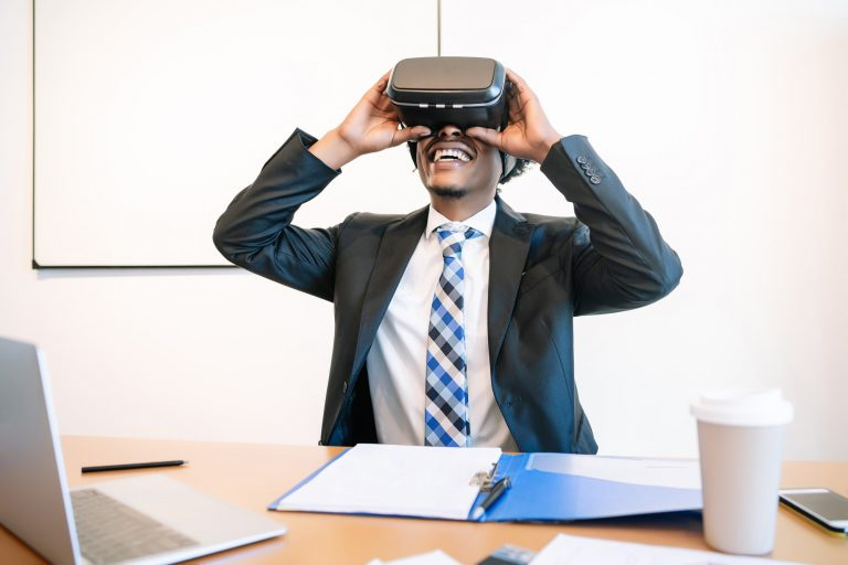 Businessman using VR glasses.