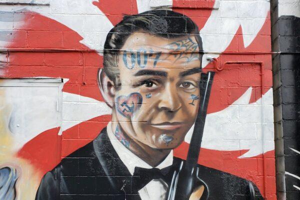 Graffiti of James Bond character on a wall