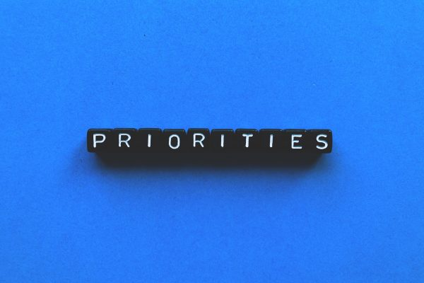 The word priorities spelt out in black tiles